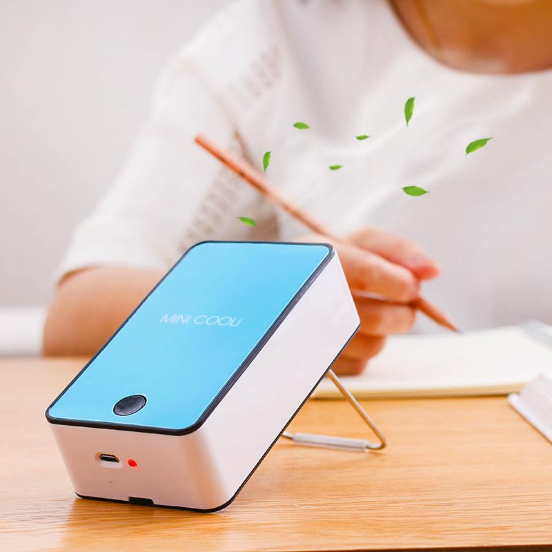 Portable portable handheld wireless air conditioning fan charging Mini Mini refrigeration small fan
