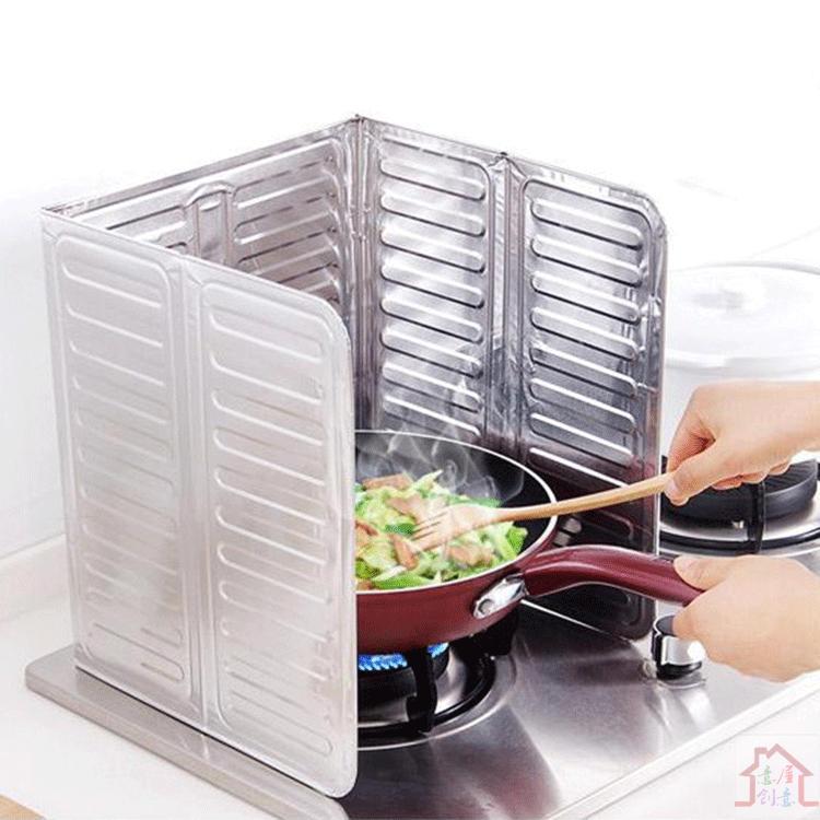 kreativa kök aluminiumfolie värmebeständigt värme olja olja ombord artefakt köksredskap verkliga produkter / person