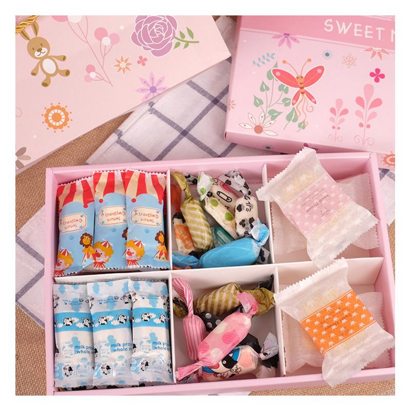 ambalarea produsului roz ca manual de nuga într - o cutie de biscuiţi cu geanta - ambalaj