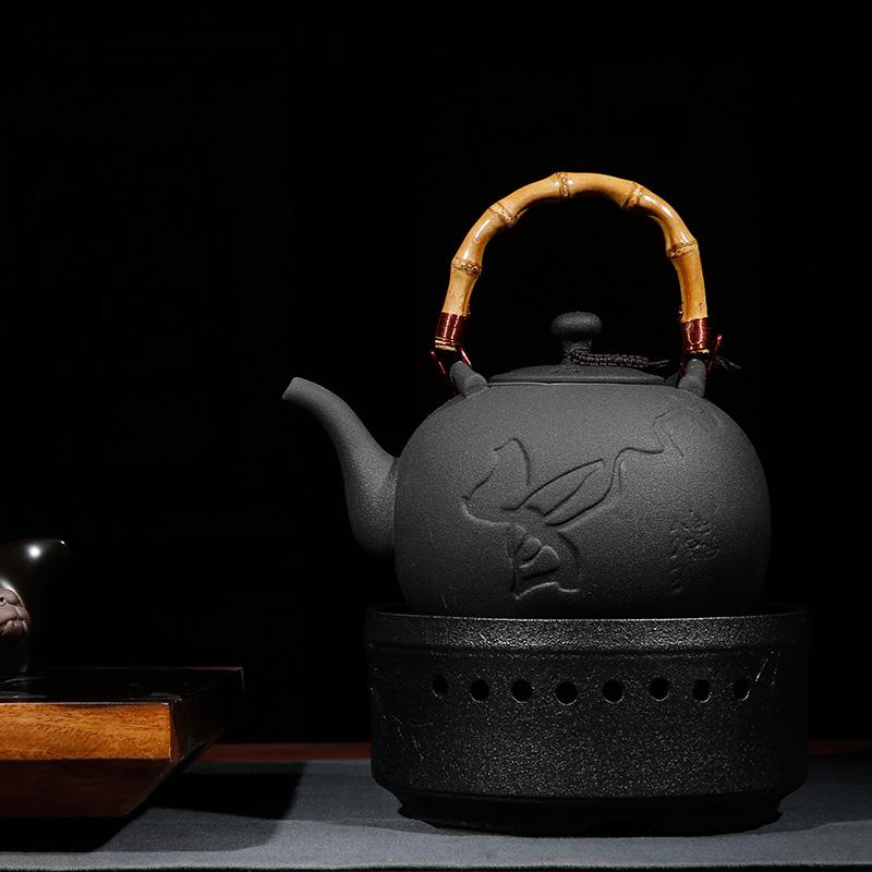 Taiwán morado la jarra de cerámica cocida automático de horno eléctrico de cerámica negro camelia tetera eléctrica un hervidor de agua de la tetera