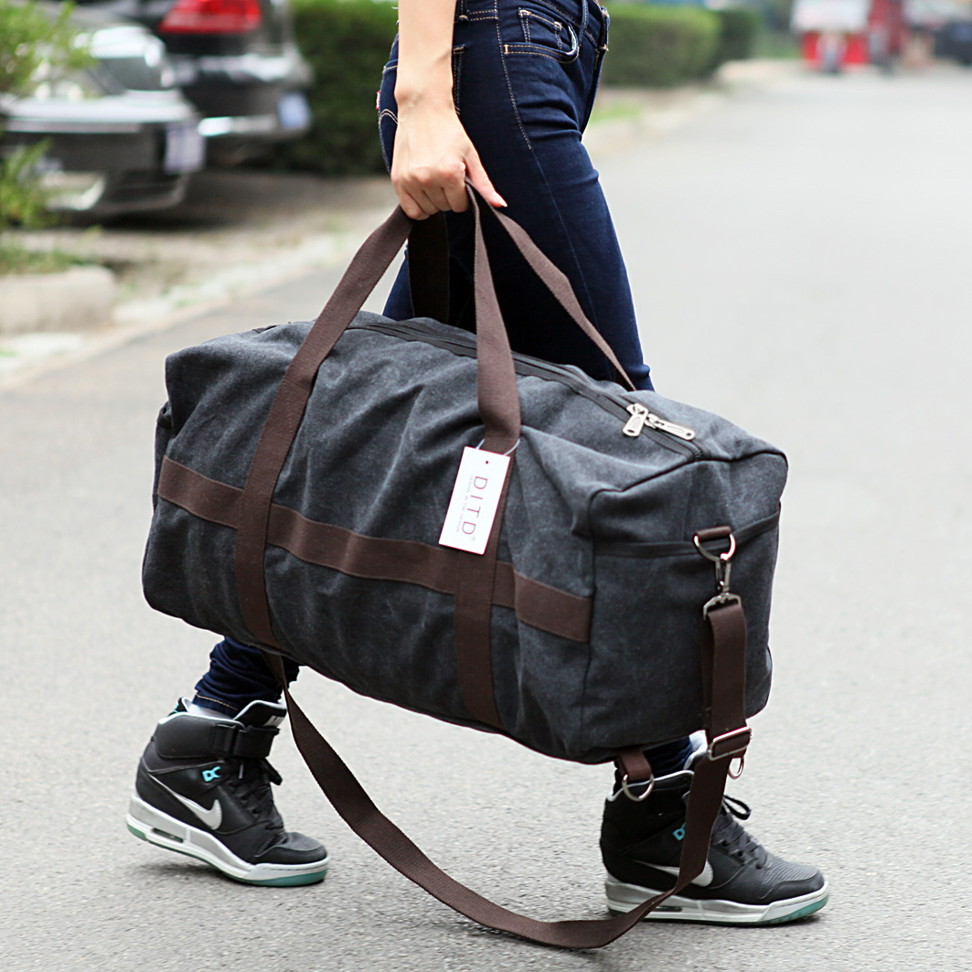 大容量运动休闲手提包旅行包男士短途出差行李包帆布旅游袋登机包