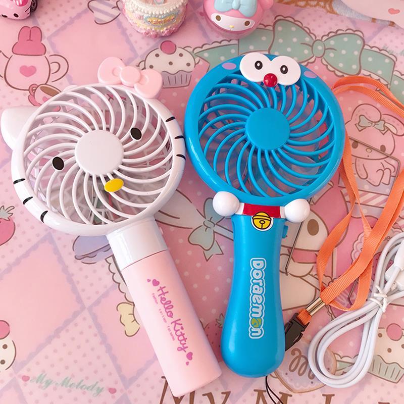 Mini ventilador de refrigeración eléctrica recargable de mano pequeño dormitorio acompañado con dibujos de los portátiles
