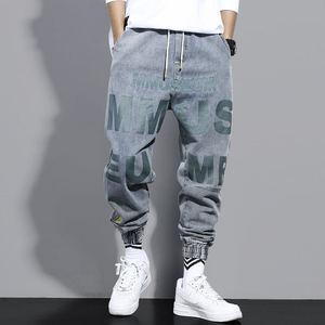 牛仔裤男秋季休闲束脚潮牌宽松工装哈伦裤