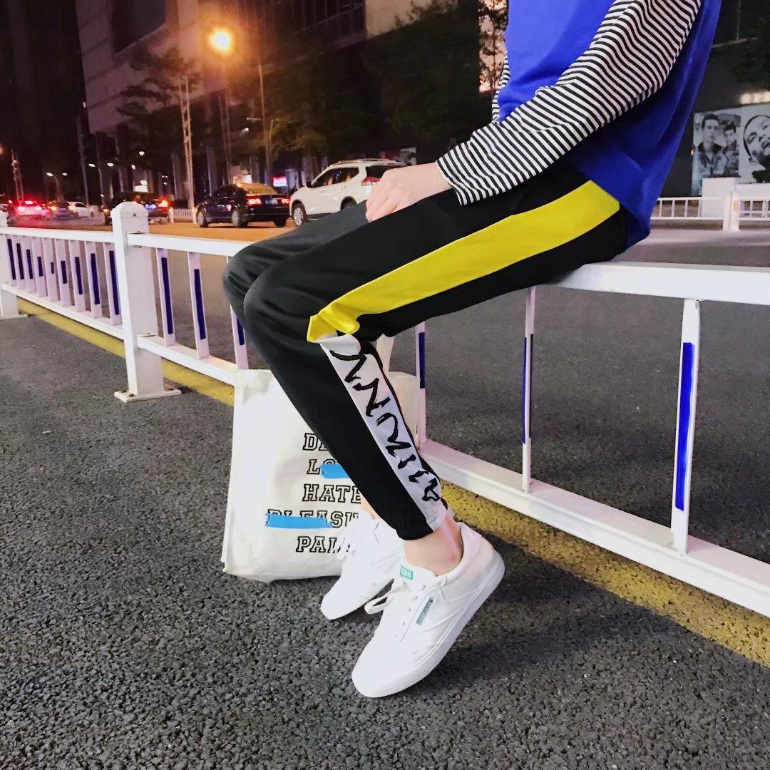 Quần thể thao nam mùa xuân và mùa hè quần âu Hàn Quốc phiên bản của phân bón để tăng quần của nam giới 200 kg thanh niên lỏng quần mỏng