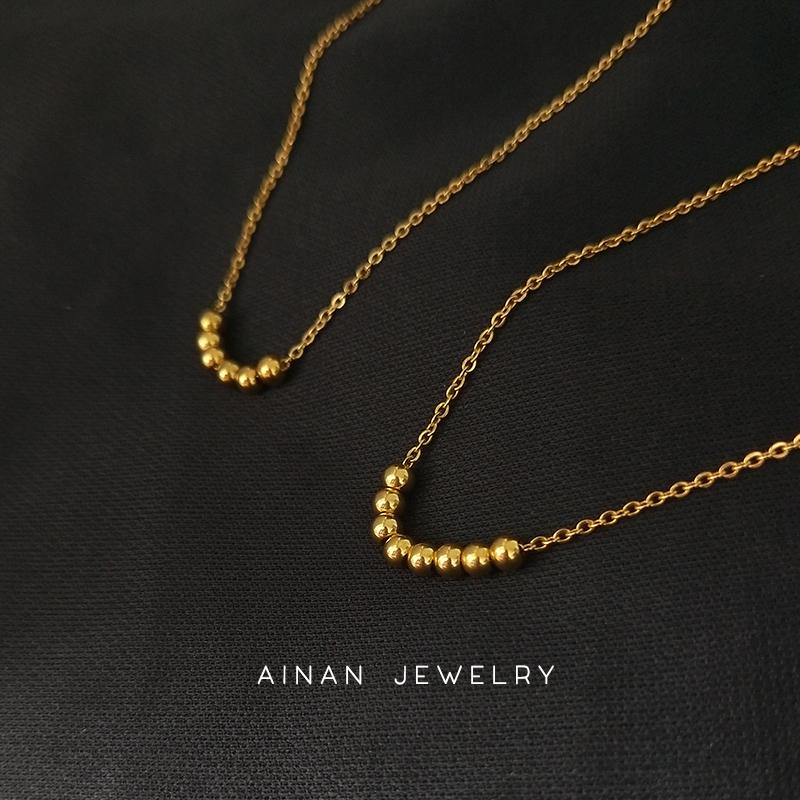 周大福焕美18K金色转运珠项链女款简约可活动金珠锁骨链不褪色饰