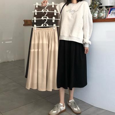 taobao agent Black half-length skirt women spring and autumn skirts, wear 2021 new winter skirts, high waist A-line skirts, mid-length spring umbrella skirts
