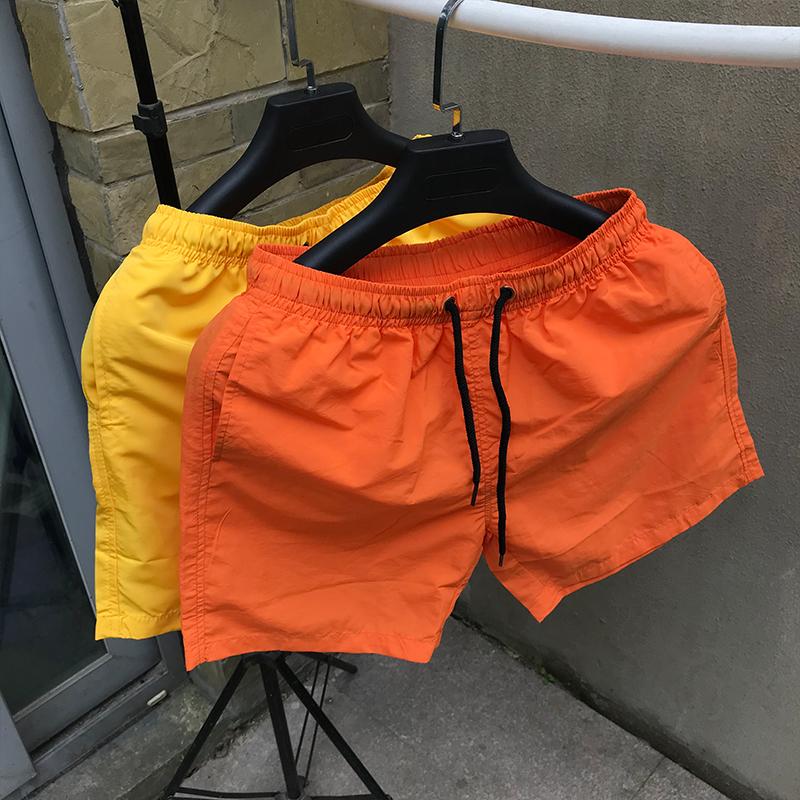 Vài quần short nam quần short mùa hè lỏng thường bãi biển quần thể thao mùa hè quần lớn quần buồn ngủ quần nhà