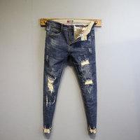 Dongdaemun thời trang cá tính thô quần hem Quần lửng Quần lửng nam xuân mới phải khoét lỗ quần jeans chín điểm
