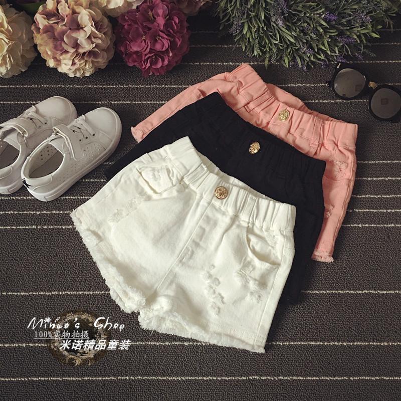 Cô gái đen trắng quần short denim mùa hè bông lỗ trẻ em Hàn Quốc phiên bản của trẻ em lớn phần mỏng quần nóng bên ngoài mặc